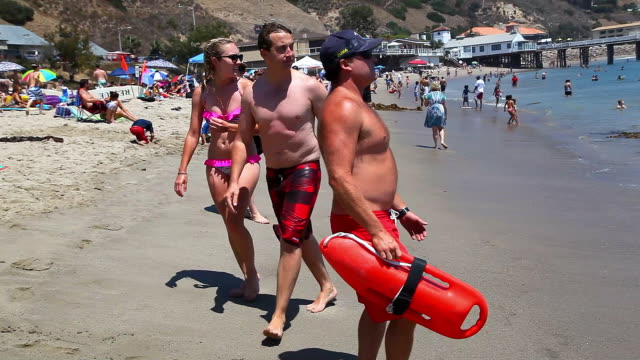 lifeguard of malibu explains to the youngster safety rules in malibu beach california no - malibu beach stock videos & royalty-free footage