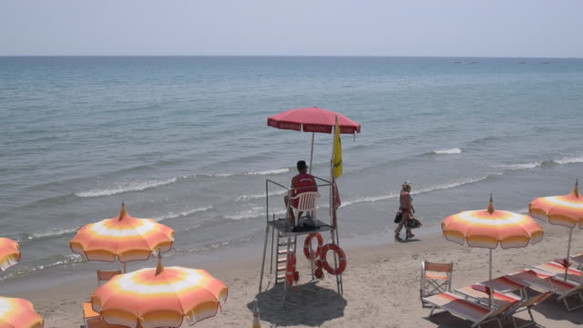 a lifeguard on beach at alassio - parasol stock videos & royalty-free footage