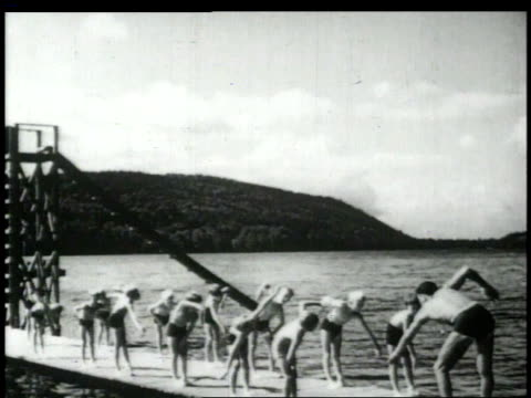 1948 montage lifeguard teaching boys to swim / united states - diving platform stock videos and b-roll footage