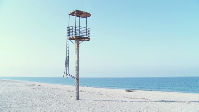 ws lifeguard tower at beach / cabo de gata, andalusia, spain  - lifeguard chair stock videos & royalty-free footage