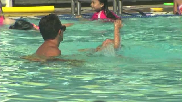 lifeguards monitor and teach children to swim on june 27, 2013 in santa clarita, california - lifeguard chair stock videos & royalty-free footage