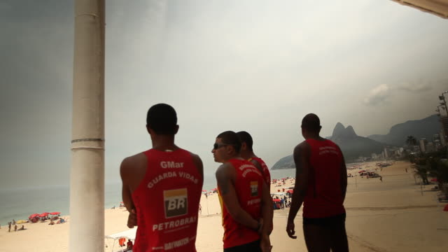 lifeguards on beach - bagnino video stock e b–roll