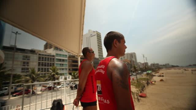 stockvideo's en b-roll-footage met lifeguards on beach - badmeester