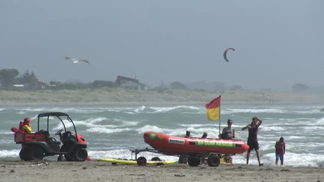 lifeguards on sumner beach with inflatable rescue boat during new zealand summer heatwave - bagnino video stock e b–roll