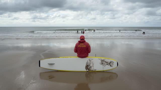 stockvideo's en b-roll-footage met rnli lifeguards on the beach. - badmeester