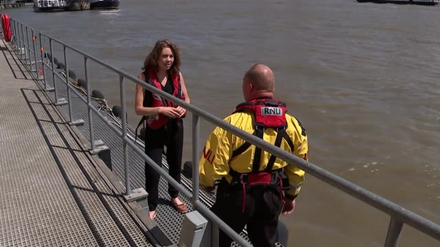Lifeguards rescue man from Thames Craig Burn along with reporter and interview SOT RNLI lifeboat in Thames