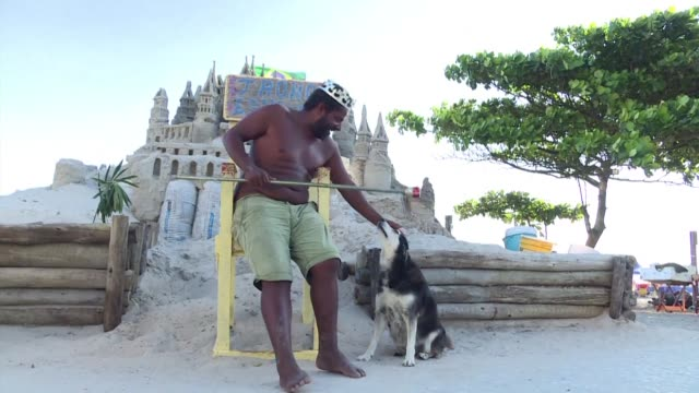 Life's a beach for a sandcastle sculptor in Rio de Janeiro who has lived 22 years in one of his creations a few steps from the ocean