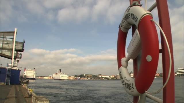 A lifesaver tube hangs from a ladder dockside in Gothenburg, Sweden.