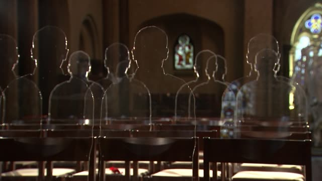 Lifesized silhouettes of First World War soldiers on display at Tower of London ENGLAND Kent Penhurst INT Choir stalls in church First World War war...