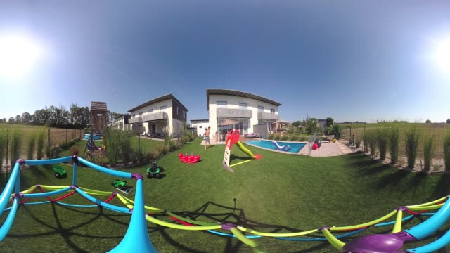 360 VR Lifestyle - happy littlie boy playing in garden 4K