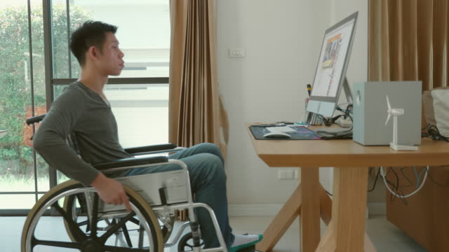 lifestyle of disabled man sitting in a wheelchair at home - disability stock videos & royalty-free footage