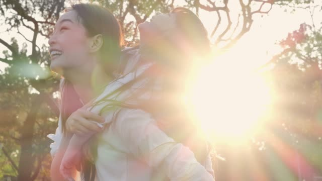 lifestyle of mom and daughter in happiness at the outside in the field at sunset light.family is doing holiday activities. asian family playing in the garden. happy family concept.relaxed parenting - southeast asia stock videos & royalty-free footage