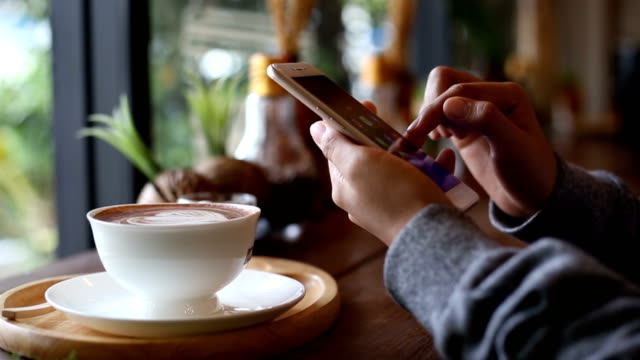 lifestyle of people at coffee shop - smart phone video stock e b–roll