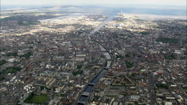 liffey river to dublin harbour  - aerial view - helicopter filming,  aerial video,  cineflex,  establishing shot,  ireland - republic of ireland stock videos & royalty-free footage