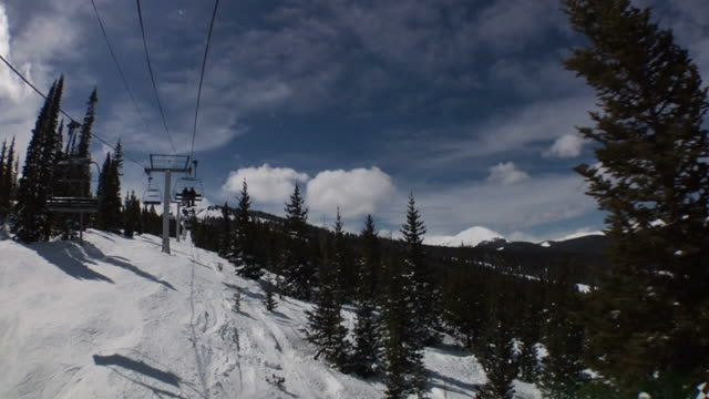 lift ride up the mountain - ski lift point of view stock videos & royalty-free footage