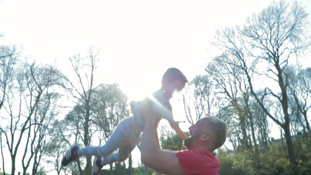 lifting and spinning his son in the air - one parent stock videos & royalty-free footage