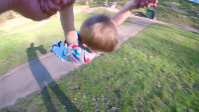 lifting and spinning his son in the air - spinning point of view stock videos & royalty-free footage