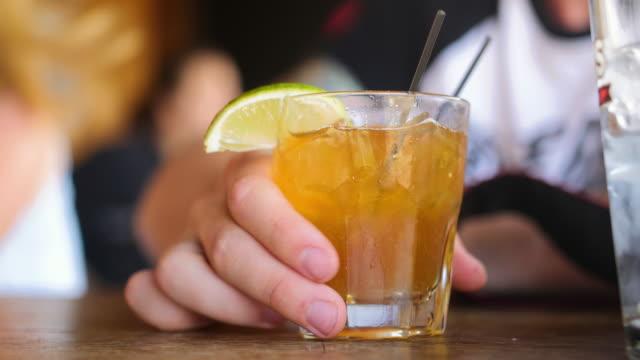 lifting glass & drinking cocktail - greifen stock-videos und b-roll-filmmaterial
