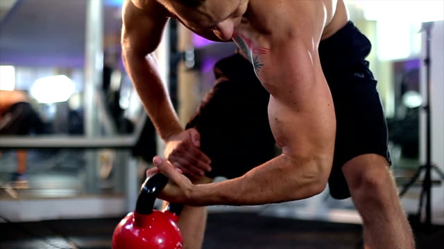 lifting ketllebells - pectoral muscle stock videos and b-roll footage