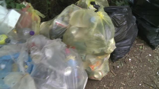lifting of lockdown sees surge in litter in parks and open spaces; uk, london; increase in littering and flytipping in london parks, open spaces and... - collection stock videos & royalty-free footage