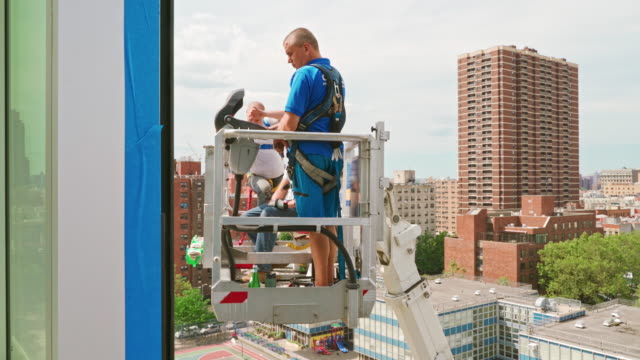lifting platform operator working on the street in harlem, nyc - repairing stock videos & royalty-free footage