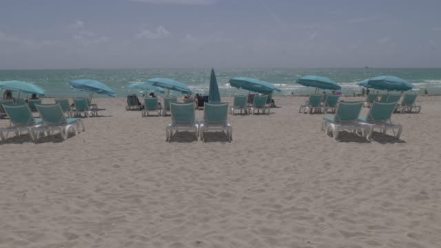 lifting shot sunshades on miami beach, south beach, miami, florida, united states of america, north america - three quarter length stock videos & royalty-free footage