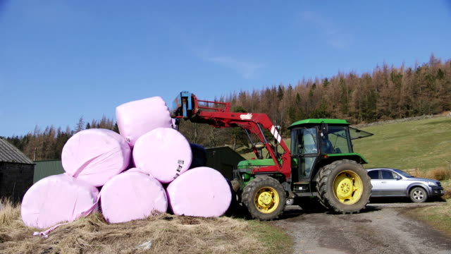 lifting silage bales - agricultural equipment stock videos & royalty-free footage