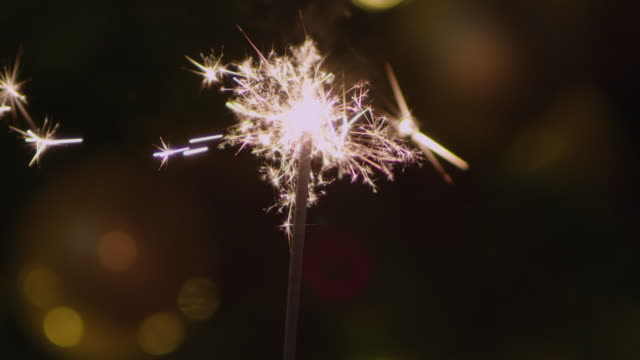 cu light a sparkler with the lighter - sparkler stock videos & royalty-free footage