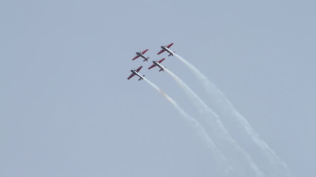 light aircraft aerial acrobatics display over aqaba city  - airshow stock videos & royalty-free footage