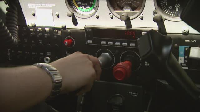 light aircraft cockpit interior, throttle and mixture lever, australia - avambraccio video stock e b–roll