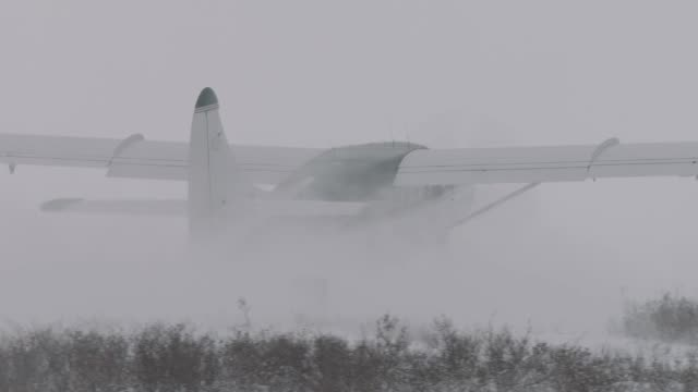 light aircraft on snowy runway, canada - runway stock videos & royalty-free footage
