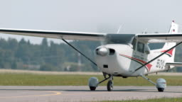 Light aircraft on the runway in sunshine
