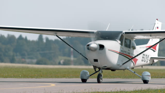 light aircraft on the runway in sunshine - glider stock videos & royalty-free footage
