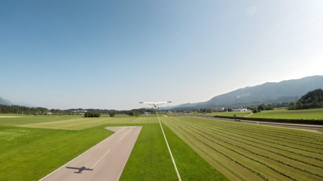 pov light aircraft towing a glider into the air in sunshine - mezzo di trasporto aereo video stock e b–roll