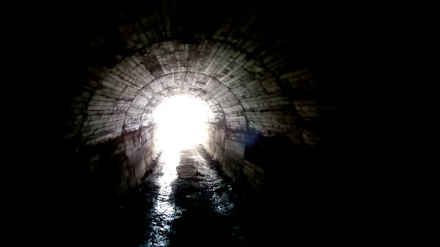 light at the end of the tunnel - cave stock videos & royalty-free footage