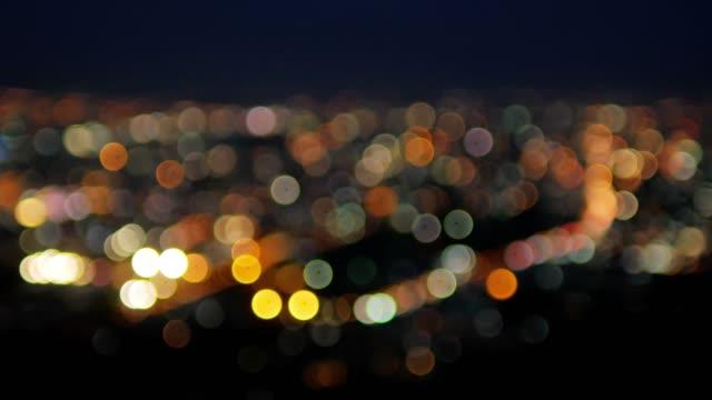vidéos et rushes de fond clair de la ville, bokeh fond, fond clair de cercle - vie nocturne