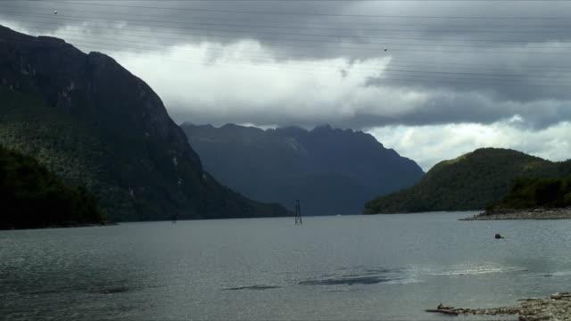 ws zo light beacon in lake te anau, te anau, southland, new zealand - new zealand stock-videos und b-roll-filmmaterial
