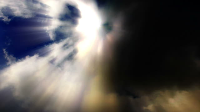 light beams of sun stream from roiling clouds in the sky. - digital enhancement stock videos & royalty-free footage