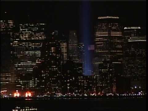 light beams representing the 2 towers of the world trade center seen along the new york city skyline. brief montage shows shots of manhattan skyline... - manhattan stock videos & royalty-free footage