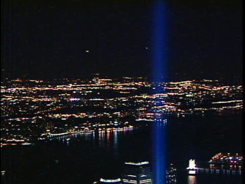 light beams representing the 2 towers of the world trade center seen along the new york city skyline. spotlights are in tribute to the six month... - manhattan stock videos & royalty-free footage