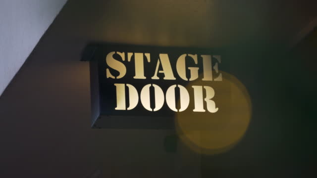 light box sign saying 'stage door' with blinking yellow light - theatre building stock videos & royalty-free footage