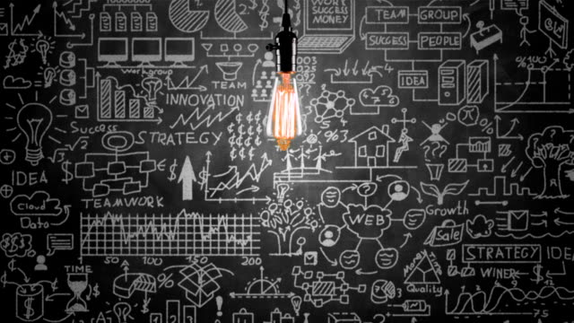 light bulb and business strategy concept on blackboard - marketing stock videos & royalty-free footage