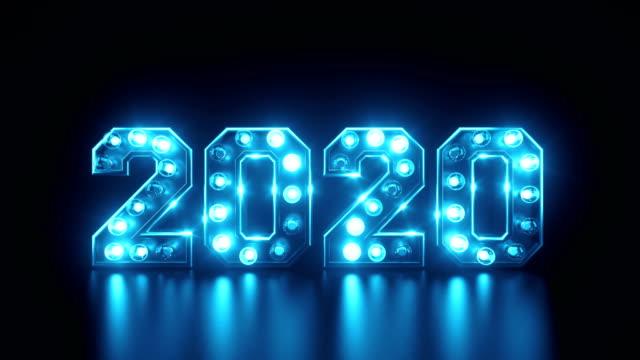 vidéos et rushes de ampoule clignotant décorée 2020 animation du nouvel an en bleu - symbole