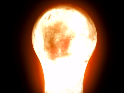 Light bulb burning out in ultra slow motion, close-up
