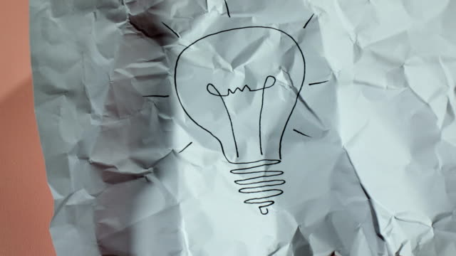light bulb drawing paper ball unwrapping