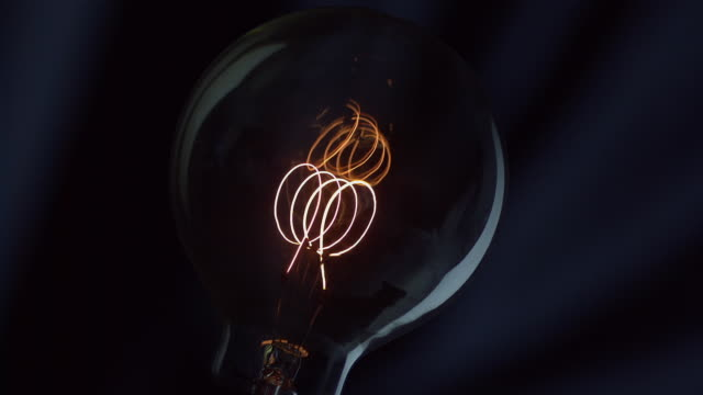 light bulb filament - lights up - filament stock videos and b-roll footage