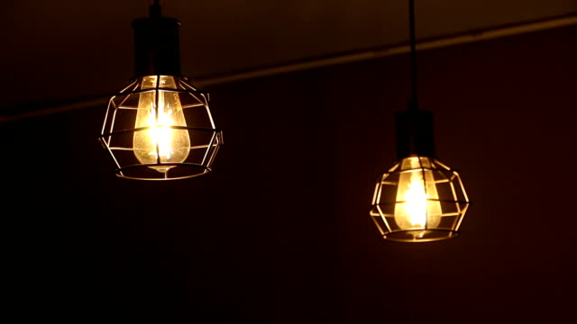 light bulb on black background, in the cafe. lonely moods. - energy efficient lightbulb stock videos and b-roll footage