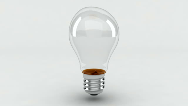 light bulb - white background stock videos & royalty-free footage