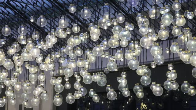 light bulbs decorate the prestigious 'bon marche' department stores during the period of christmas shopping and black friday postponed in france due... - gourmet stock videos & royalty-free footage