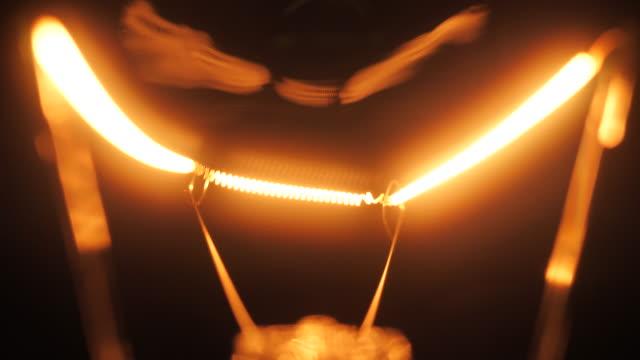 light bulbs illuminate, close-up - tungsten image stock videos and b-roll footage